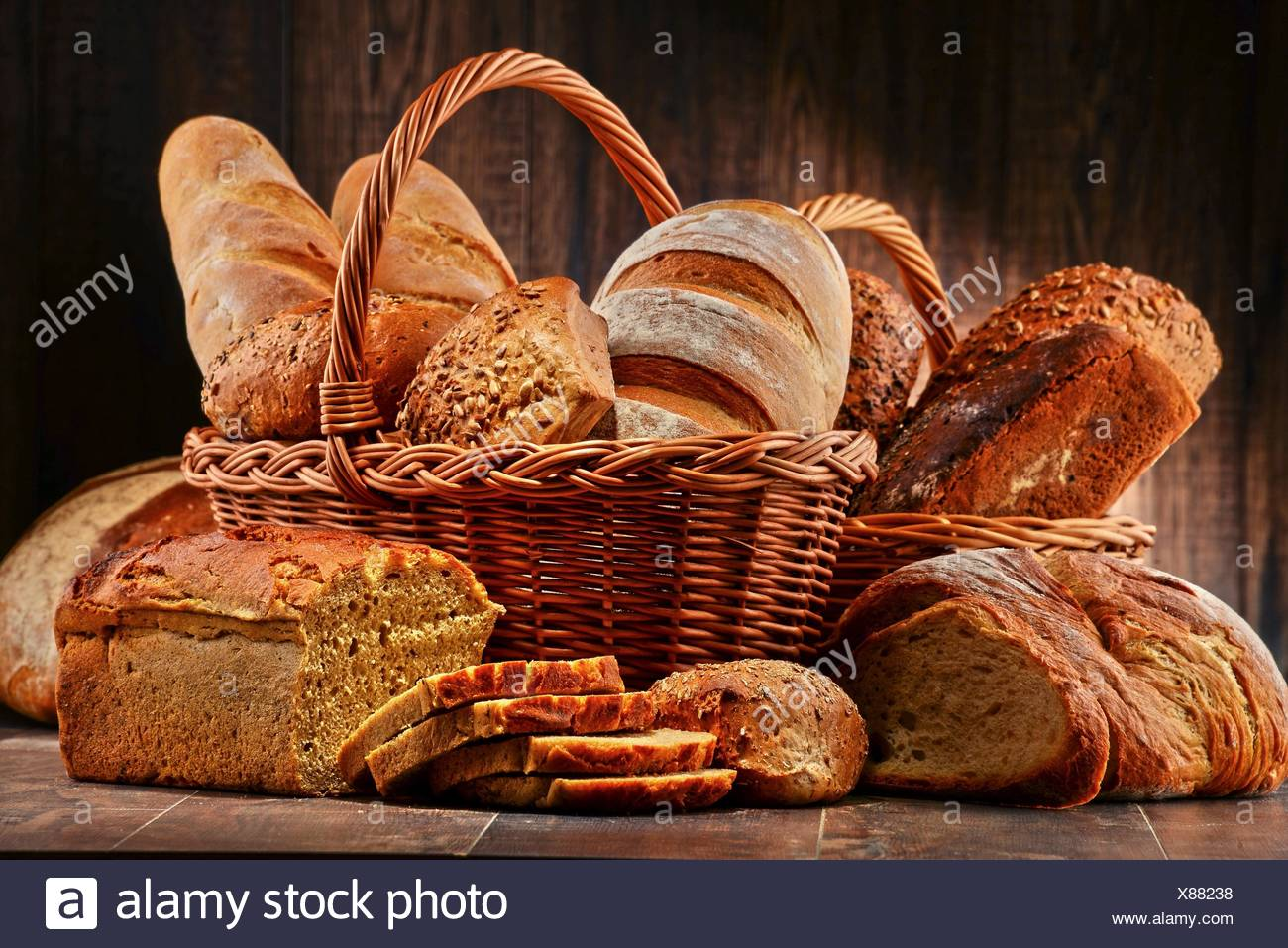 Composition with variety of baking products on wooden table. - Stock Image