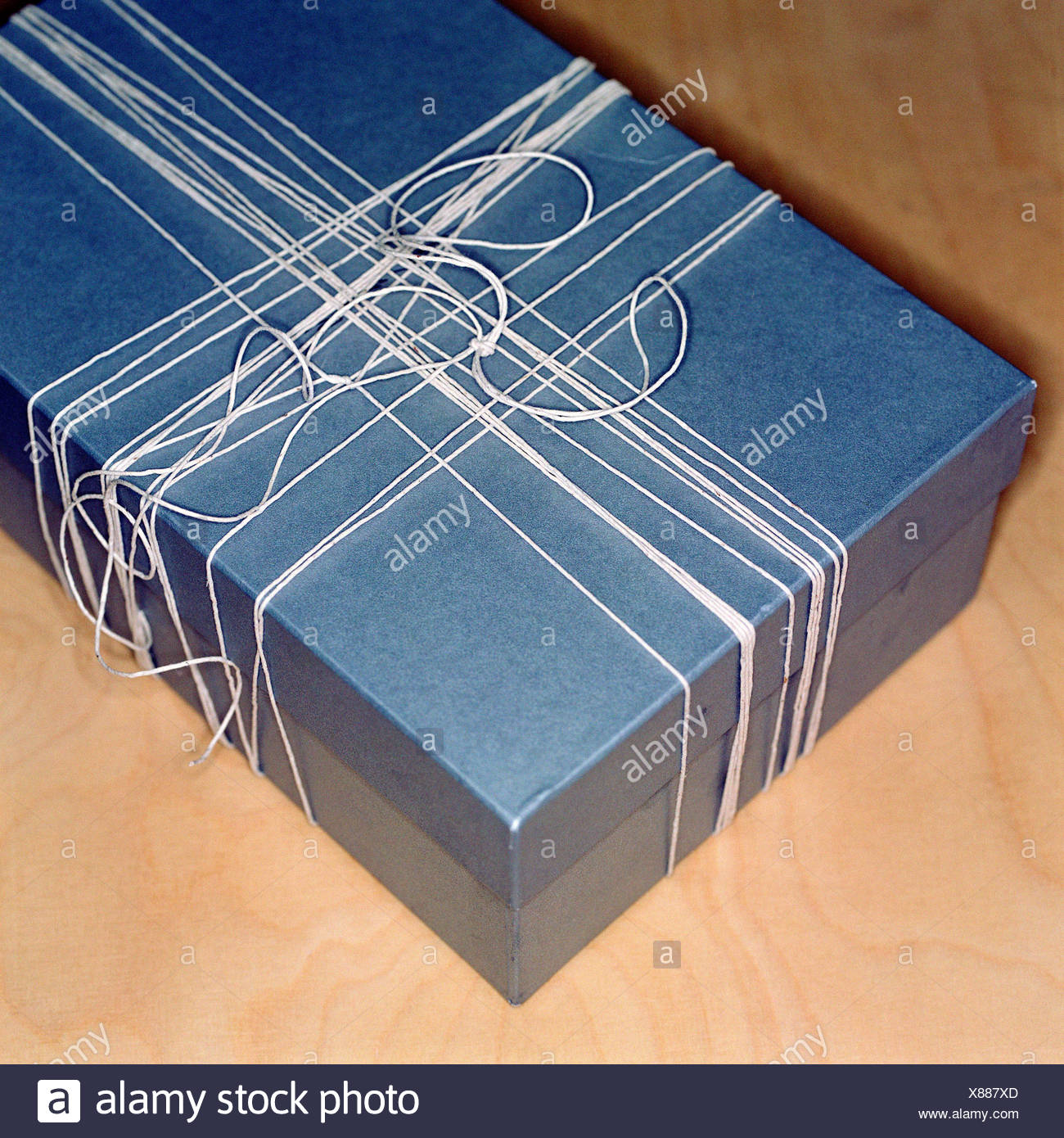 Box tied with ribbon - Stock Image