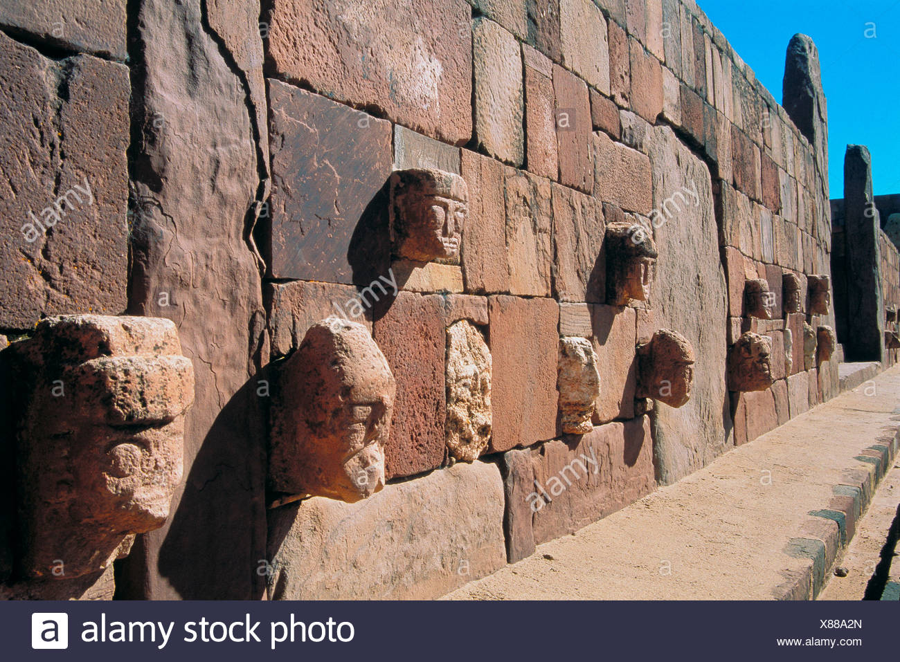 Bolivia South America in Titicacasee temple wall him faces heads Tiahuanaco culture - Stock Image