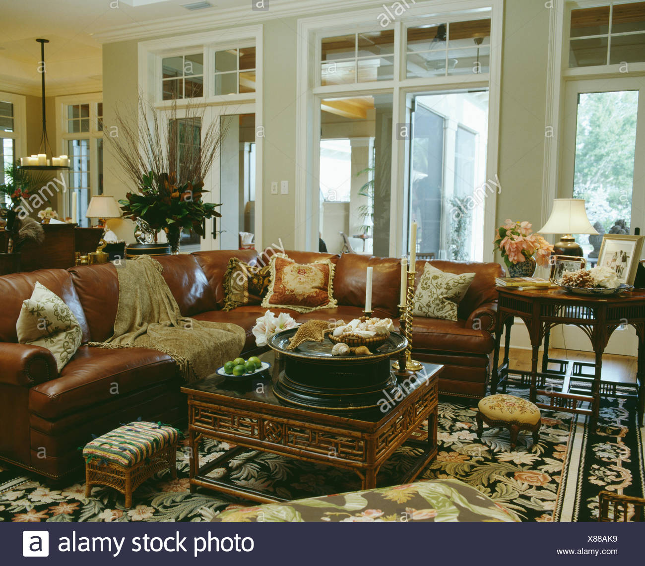 Oriental-style coffee table in front of large brown leather ...