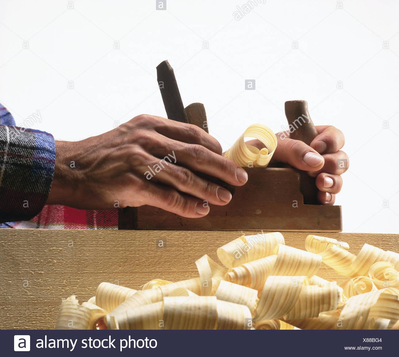 Carpenters, work, chop detail, hands, planes man, wood processing, shavings, wood shavings, occupation, work, work, craft, craftsman - Stock Image