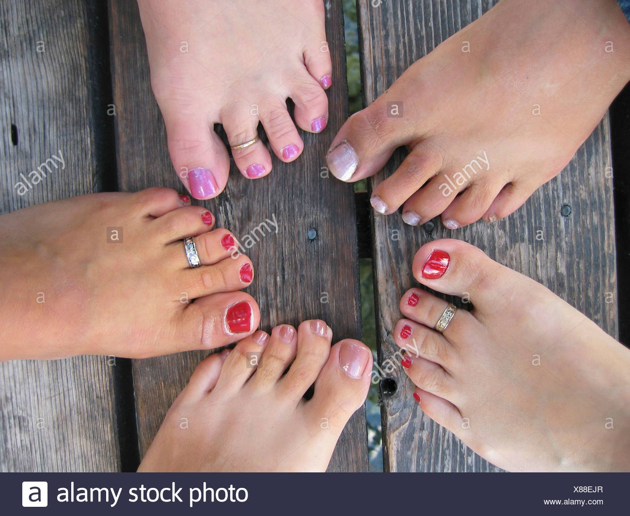 Swell Womens Feet With Painted Toenails On Old Wood Dock Stock Unemploymentrelief Wooden Chair Designs For Living Room Unemploymentrelieforg