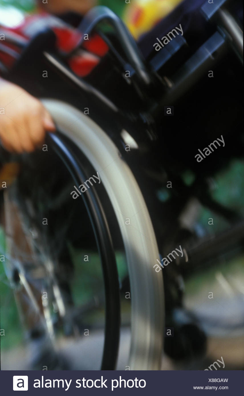 Mid section view of person sitting on wheelchair - Stock Image