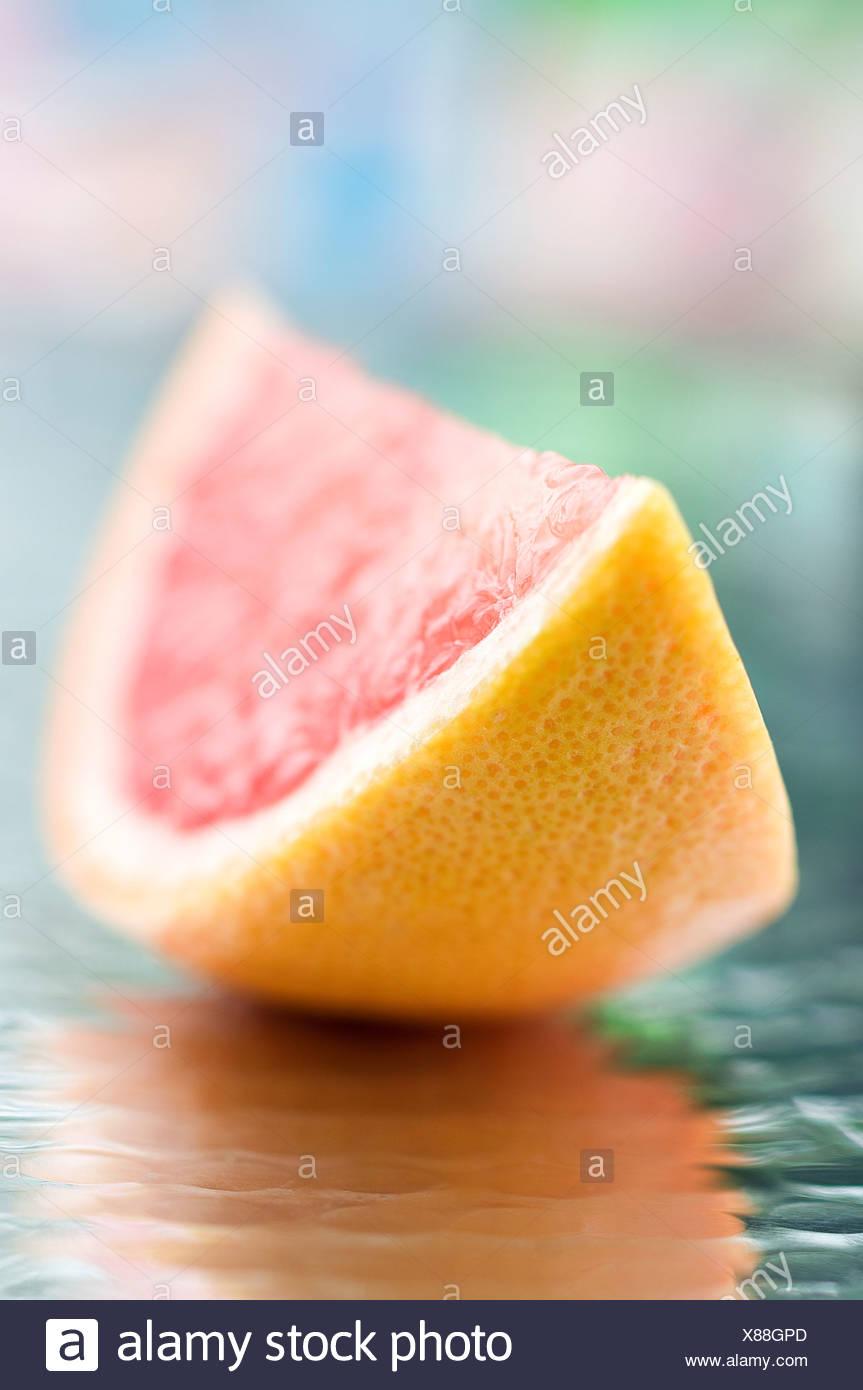 A slice of grapefruit - Stock Image