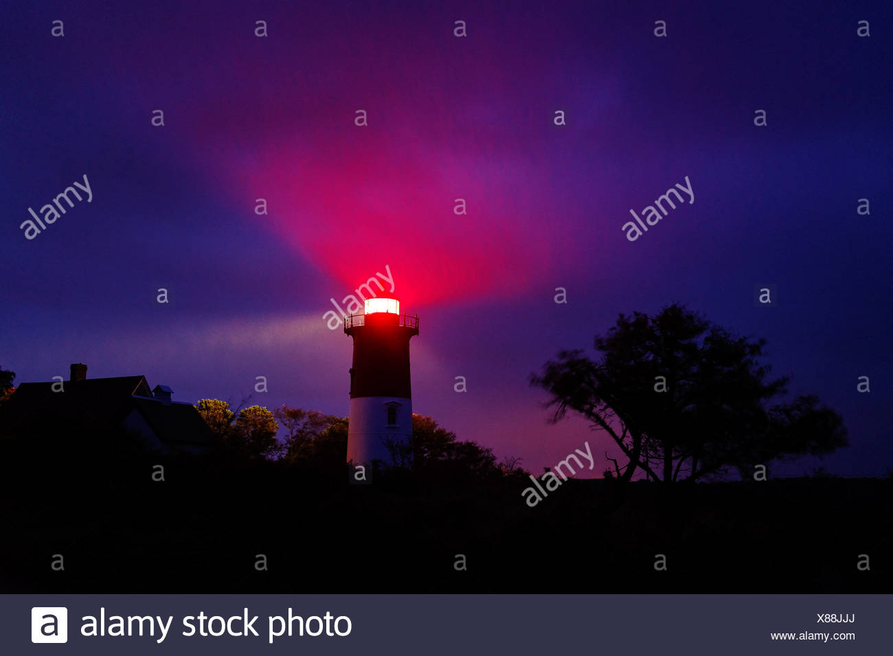 Nauset Light shines during a stormy night, Eastham, Cape Cod, MA, USA - Stock Image