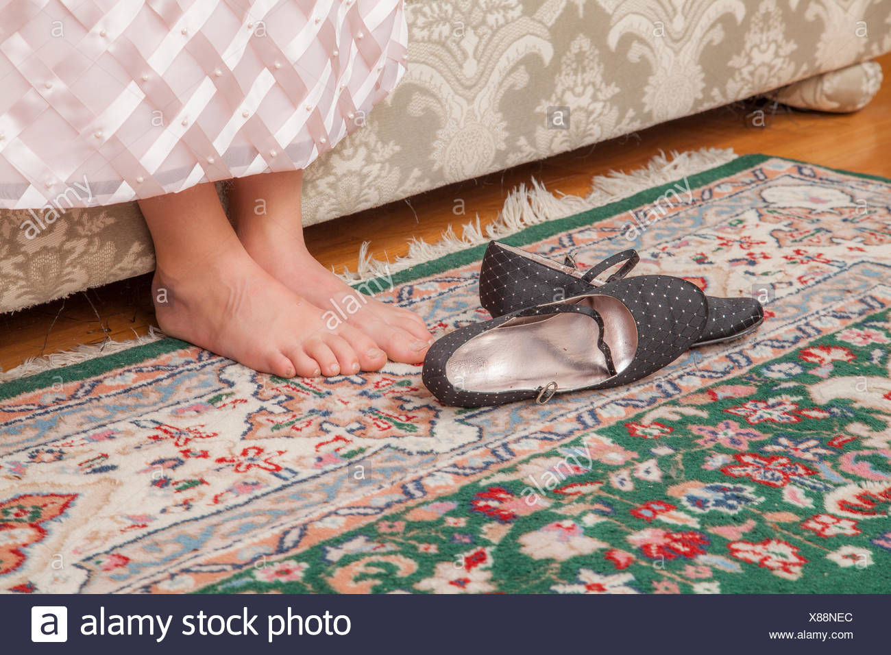 Young girl's bare feet. - Stock Image