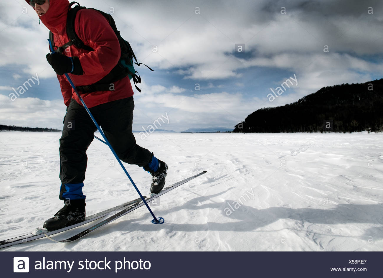Skiing on the frozen tundra of Moosehead Lake, Maine. - Stock Image