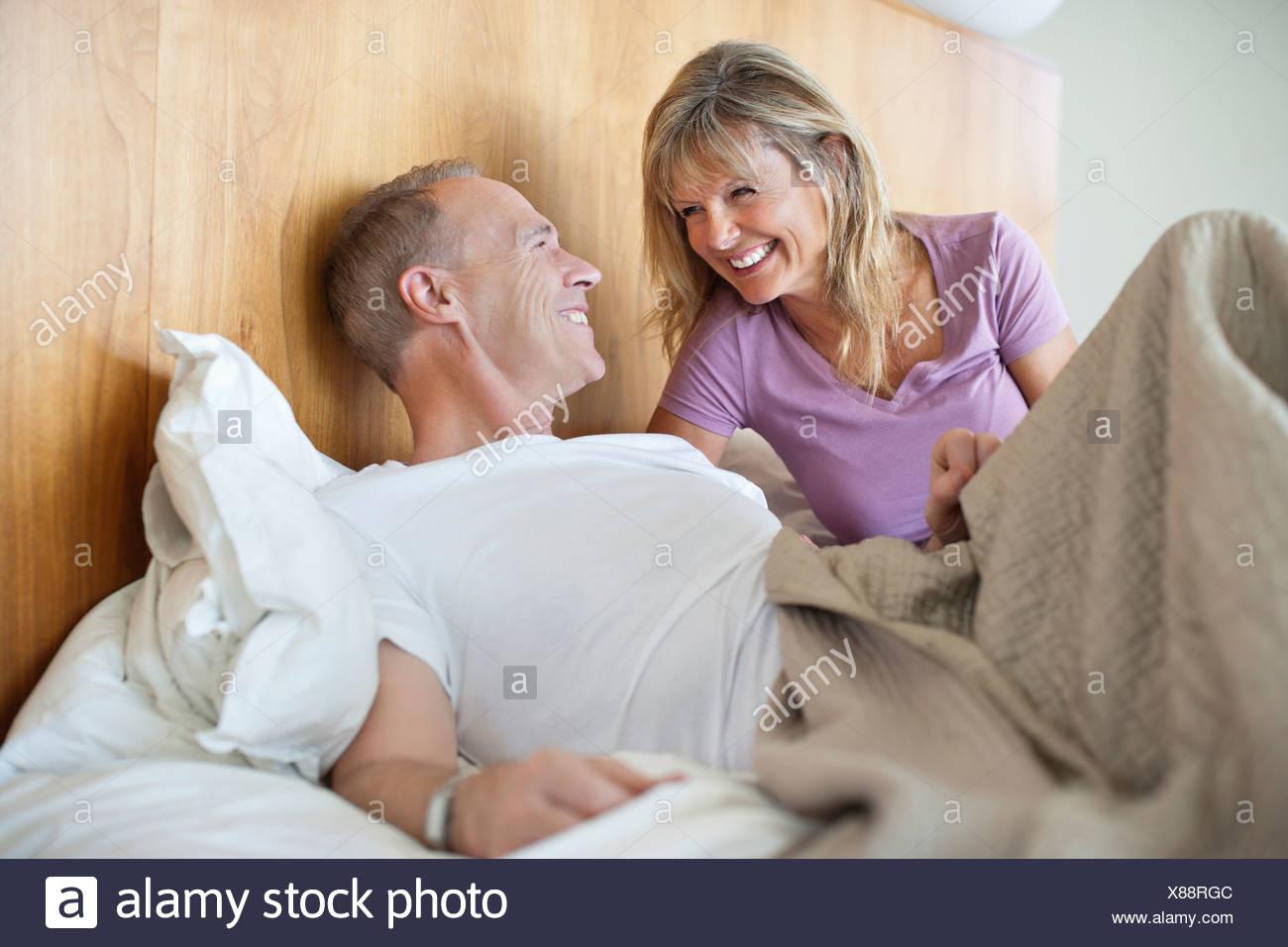 Happy senior couple in bed - Stock Image