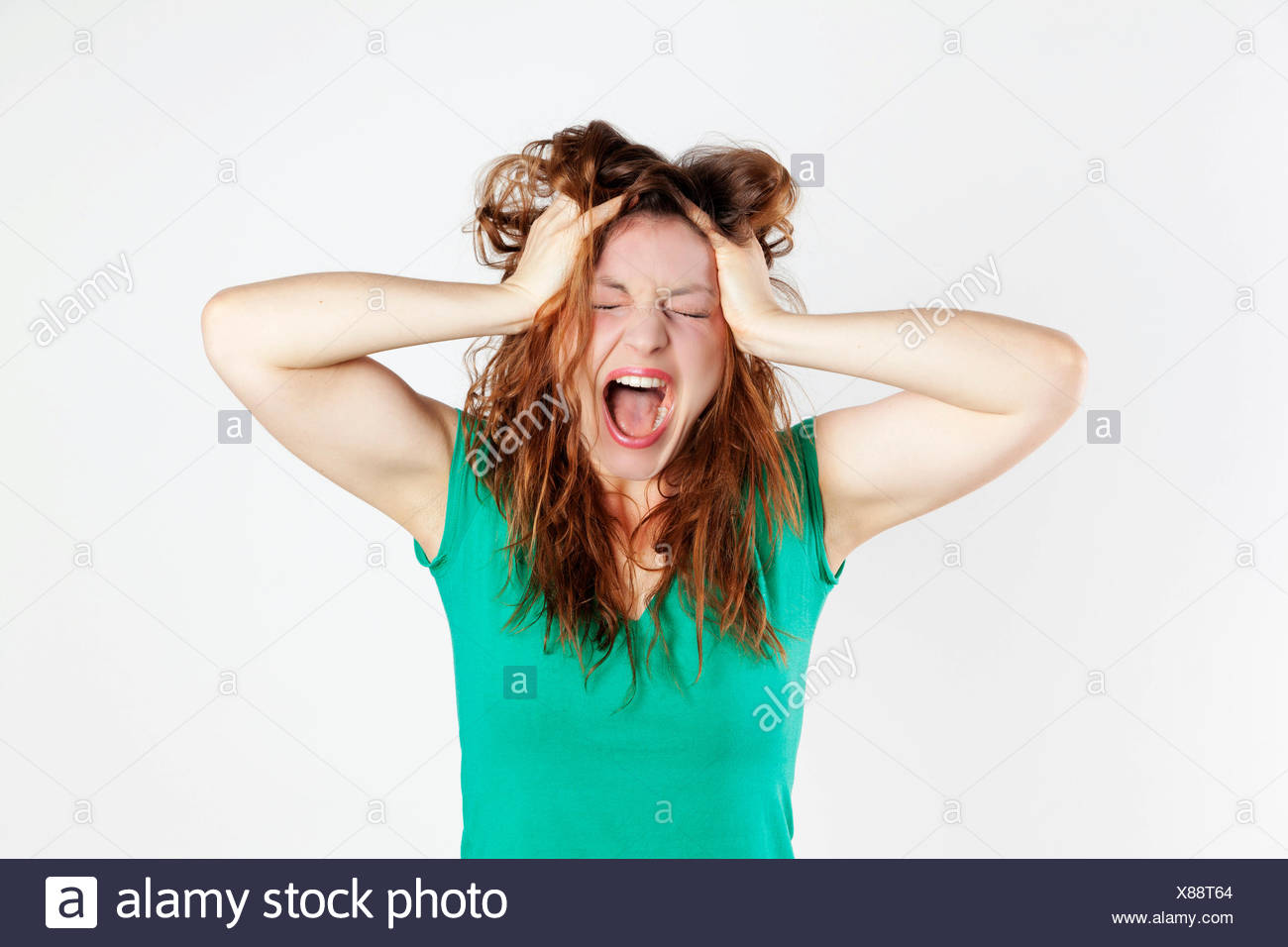 Desperate young woman screaming - Stock Image