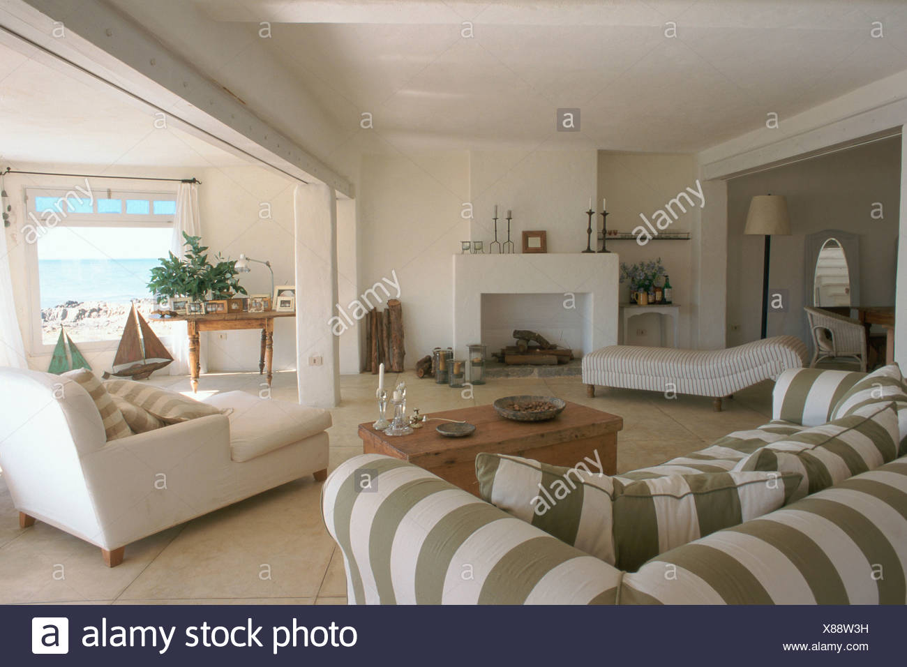 Living-room white couches coffee table white chimney beach ...
