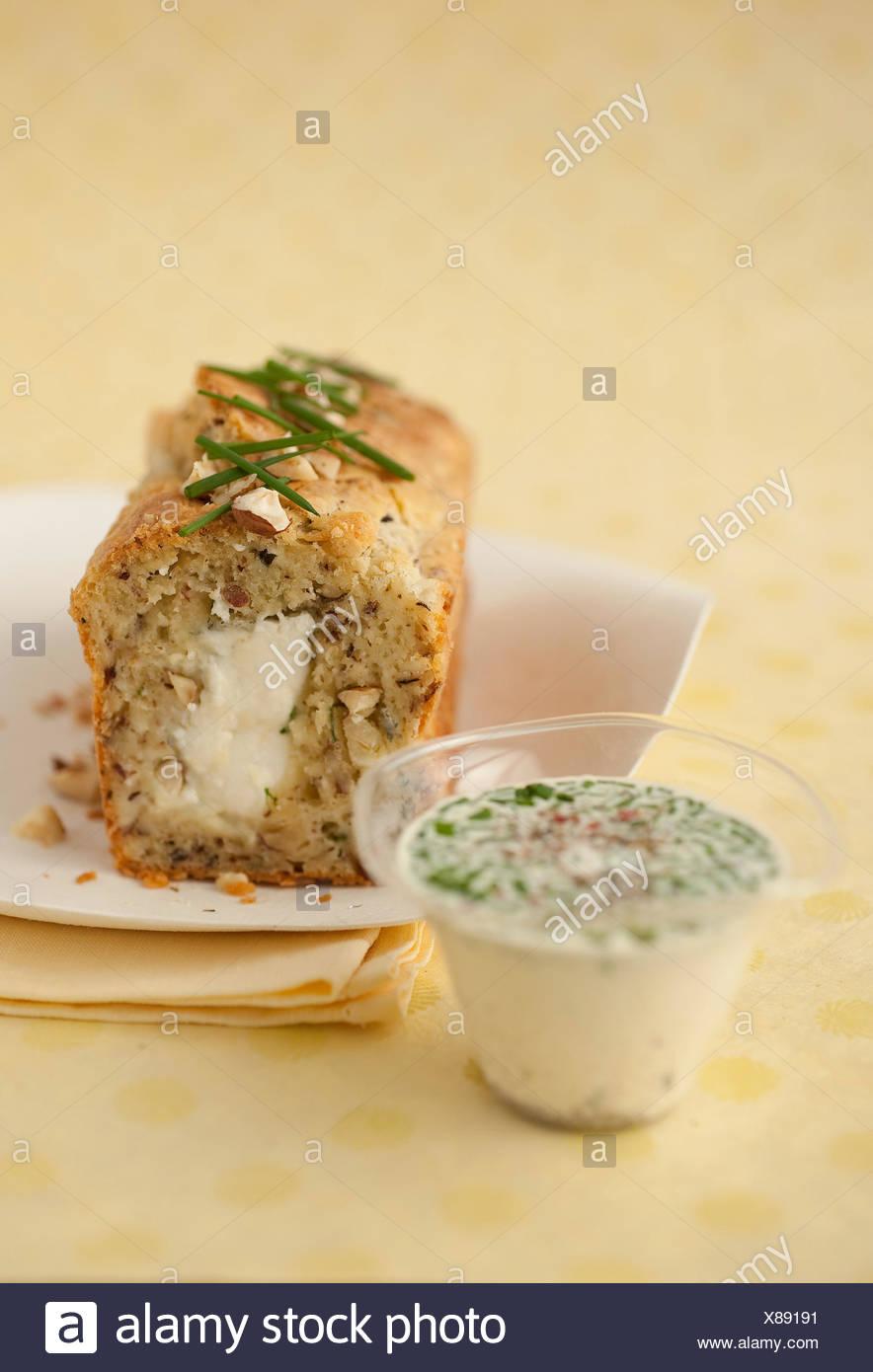 Goat's cheese,hazelnut and chive savoury cake,creamy chive sauce - Stock Image