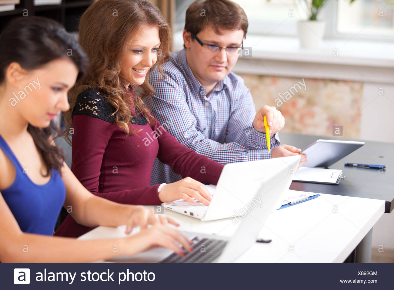 Group of students  in computer lab - Stock Image