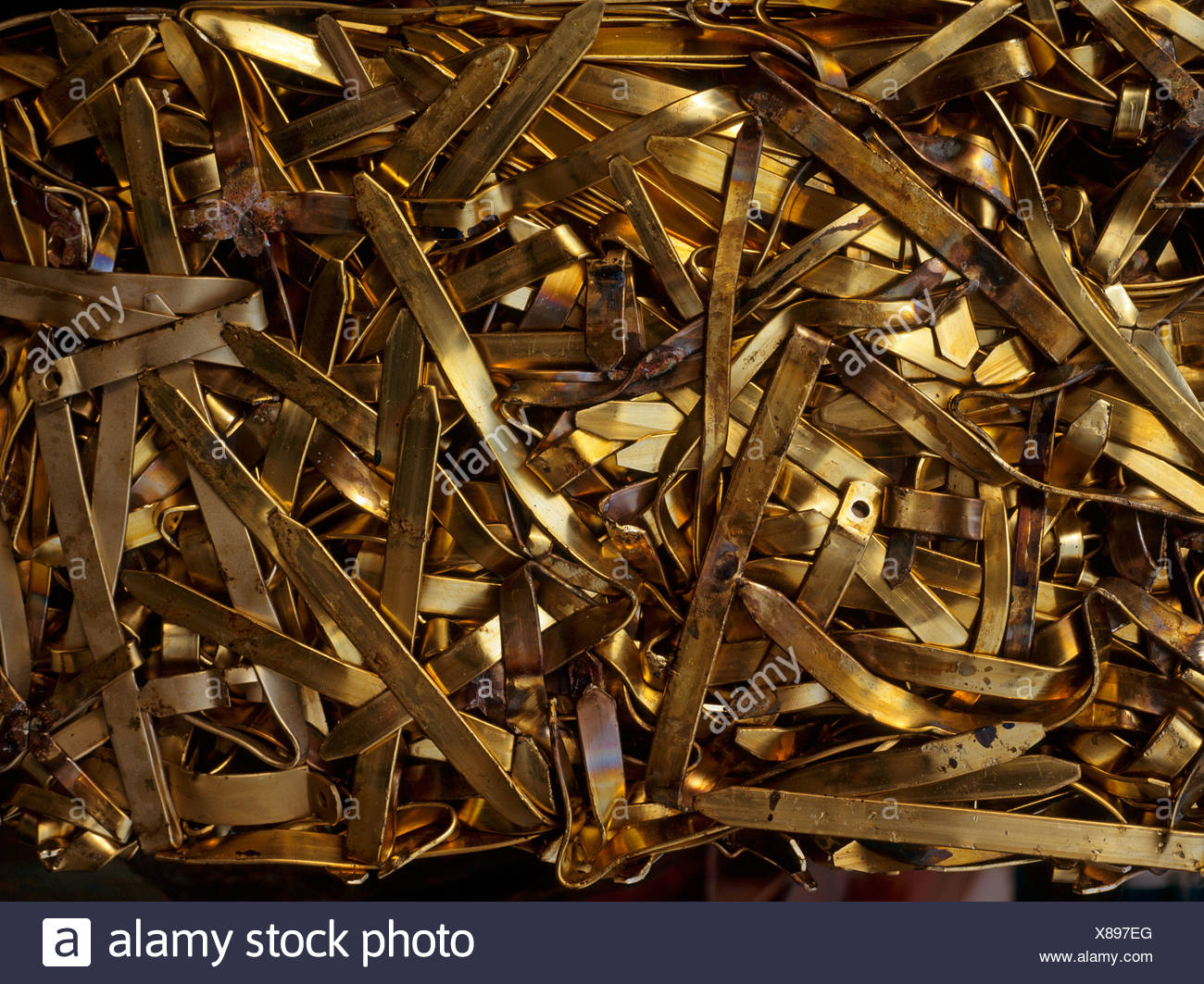 Bronze metal compressed prior to recycling North Wales UK - Stock Image