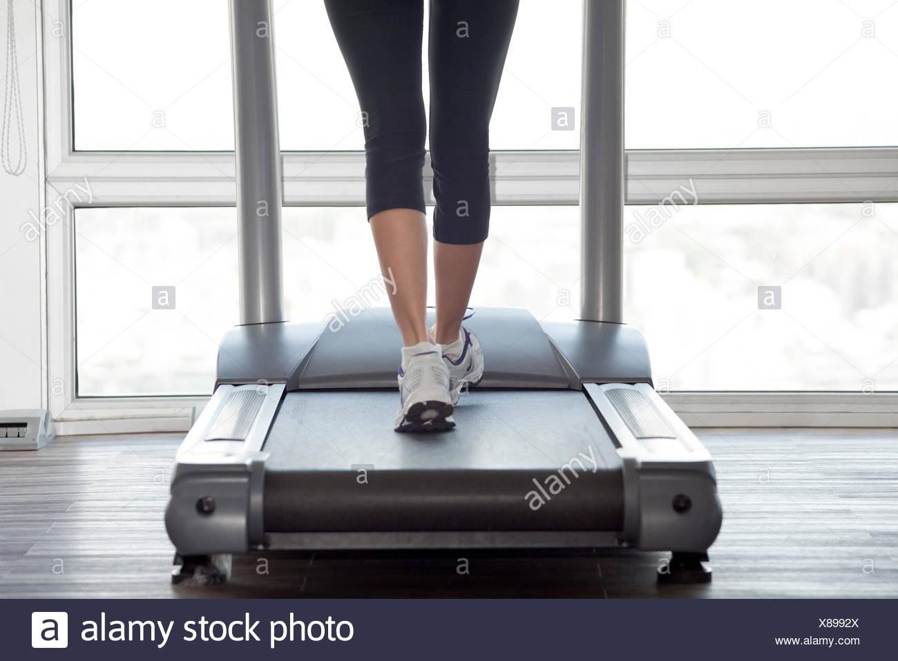 Using treadmill - Stock Image