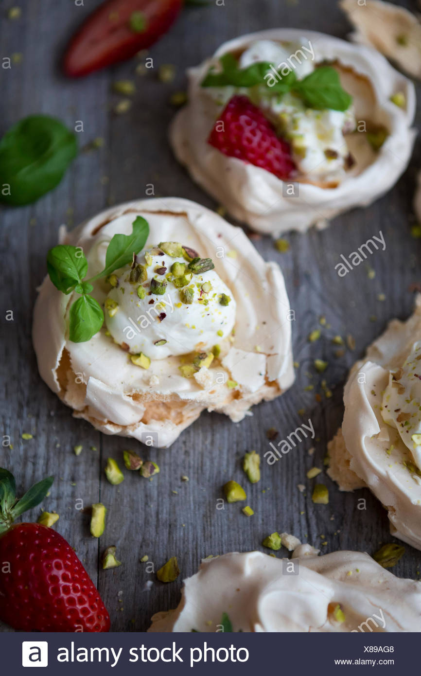 Strawberry, Pistachio & Basil Mini Meringues - Stock Image