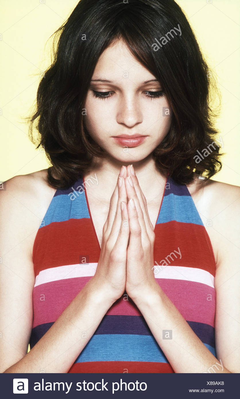 Young persons, view lowered, pray, portrait, Ti5, women's portrait, girl, teenager, 14 years, puberty, seriously, think, consider, Contemplative, religion, faith, cult, sect, orientation, everyday flight, innocence, influencing, confirmation, religiousnes - Stock Image