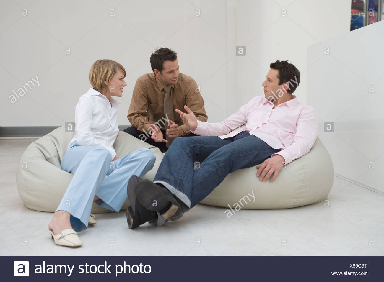 group of friends having a conversation - Stock Image
