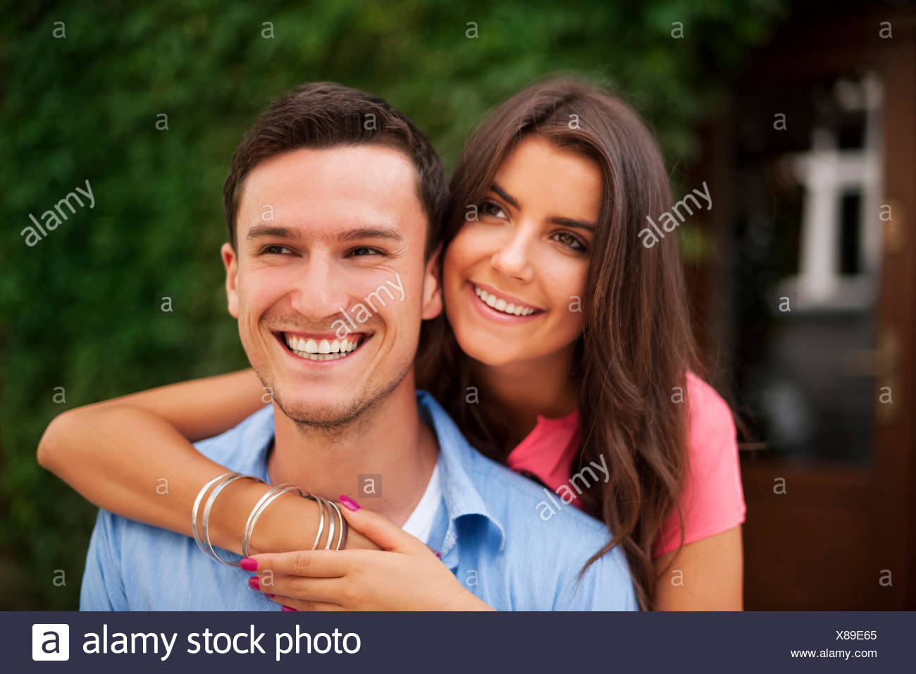 Cute couple looking at the same direction, Debica, Poland - Stock Image