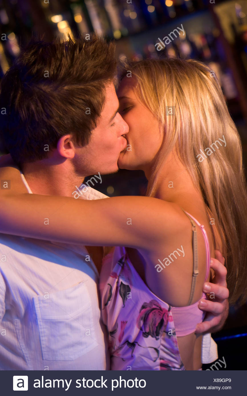 Young couple kissing in a bar Stock Photo