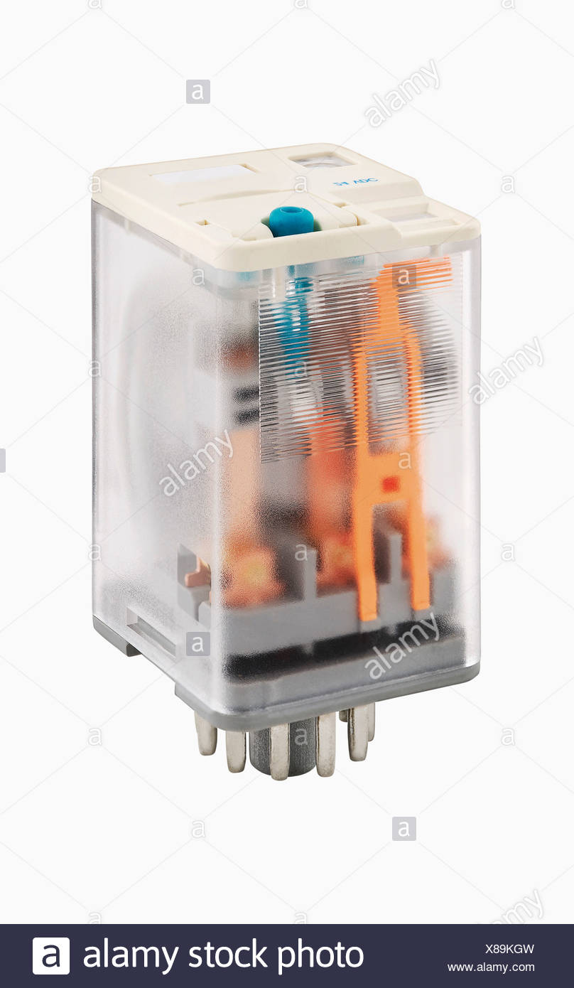 Relays in transparent housing on white background - Stock Image