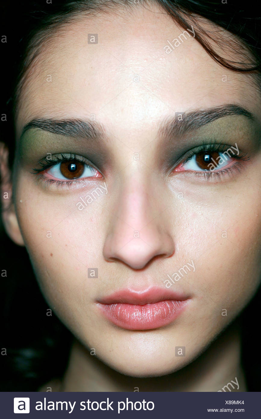 Costume National Backstage Paris Autumn Winter Model brunette hair, brown eyes, wearing dark olive green eyeshadow blended up