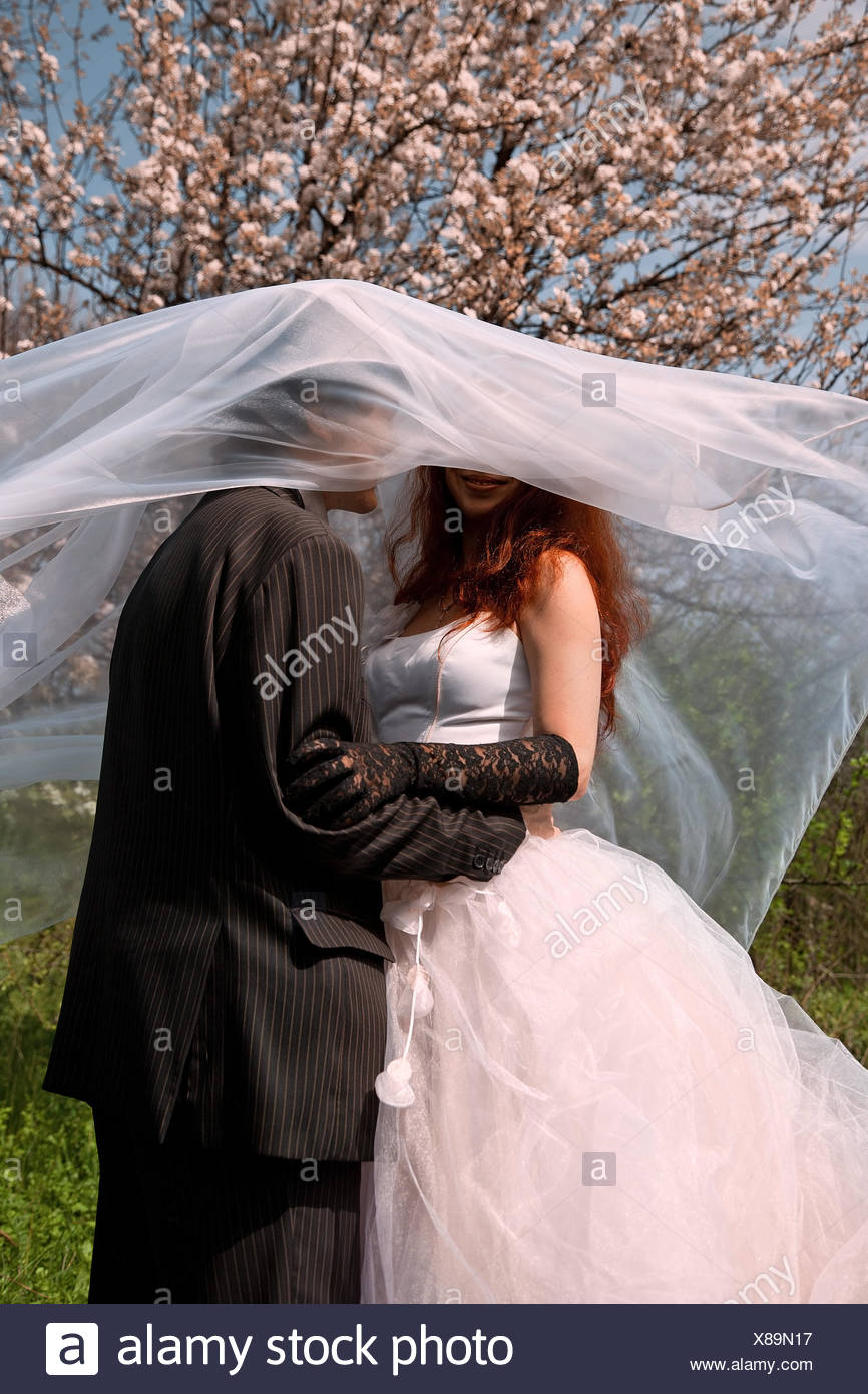 couple under vail. outdoor shot - Stock Image