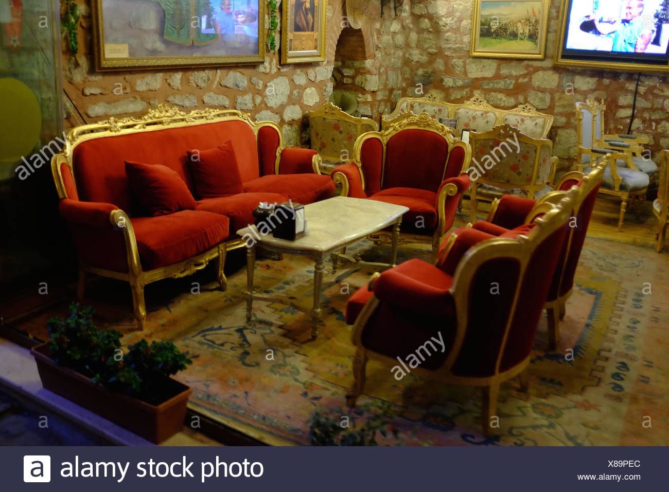 a red sofa and armchairs welcome guests at a coffeeshop in istanbul