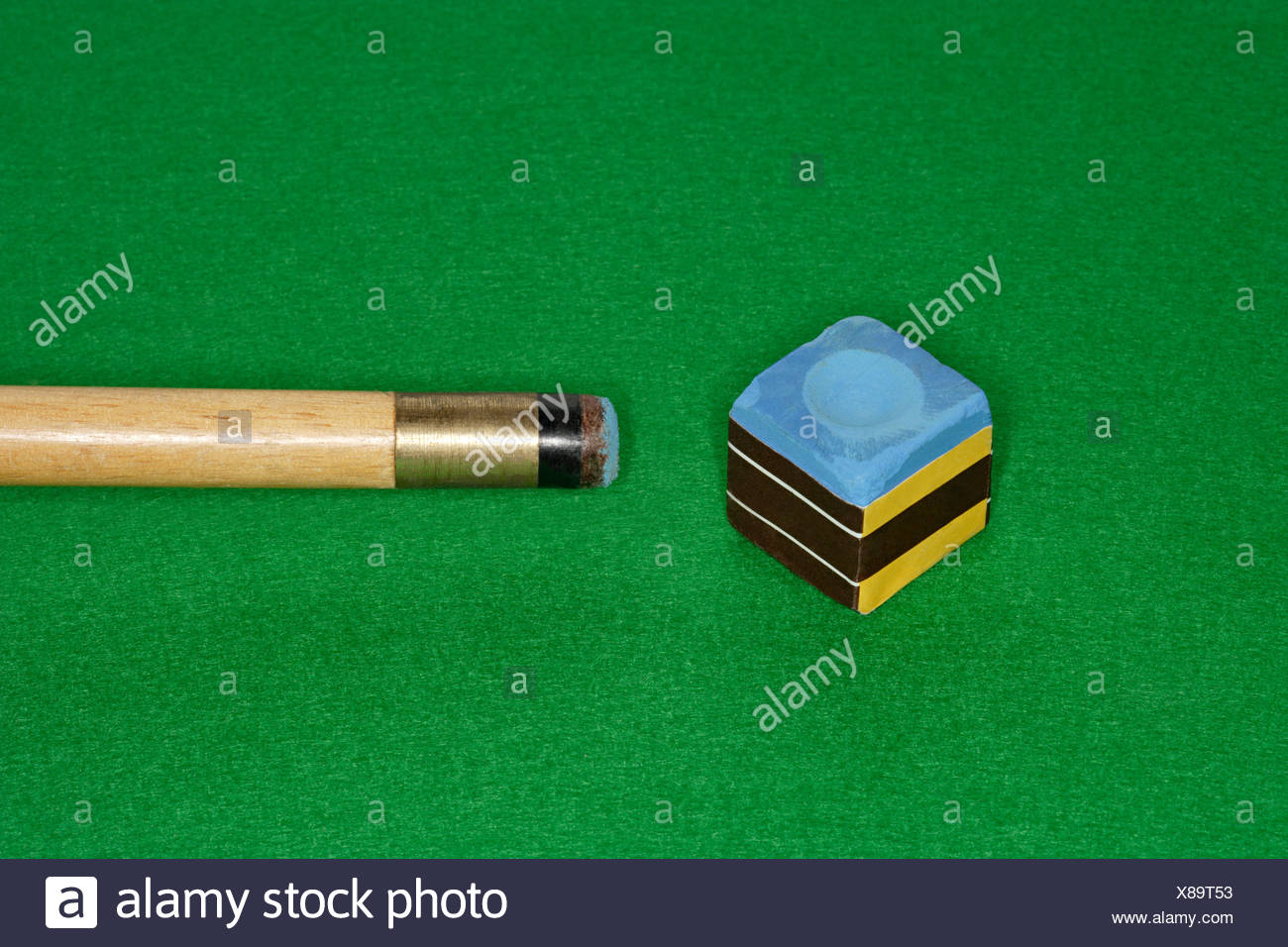 Snooker cue and chalk - Stock Image