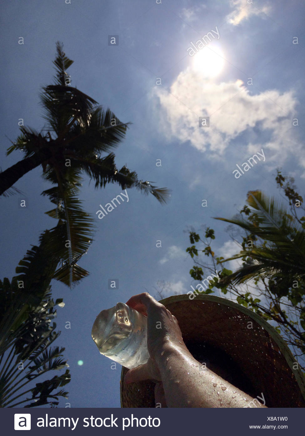 Woman drinking water in hot weather - Stock Image