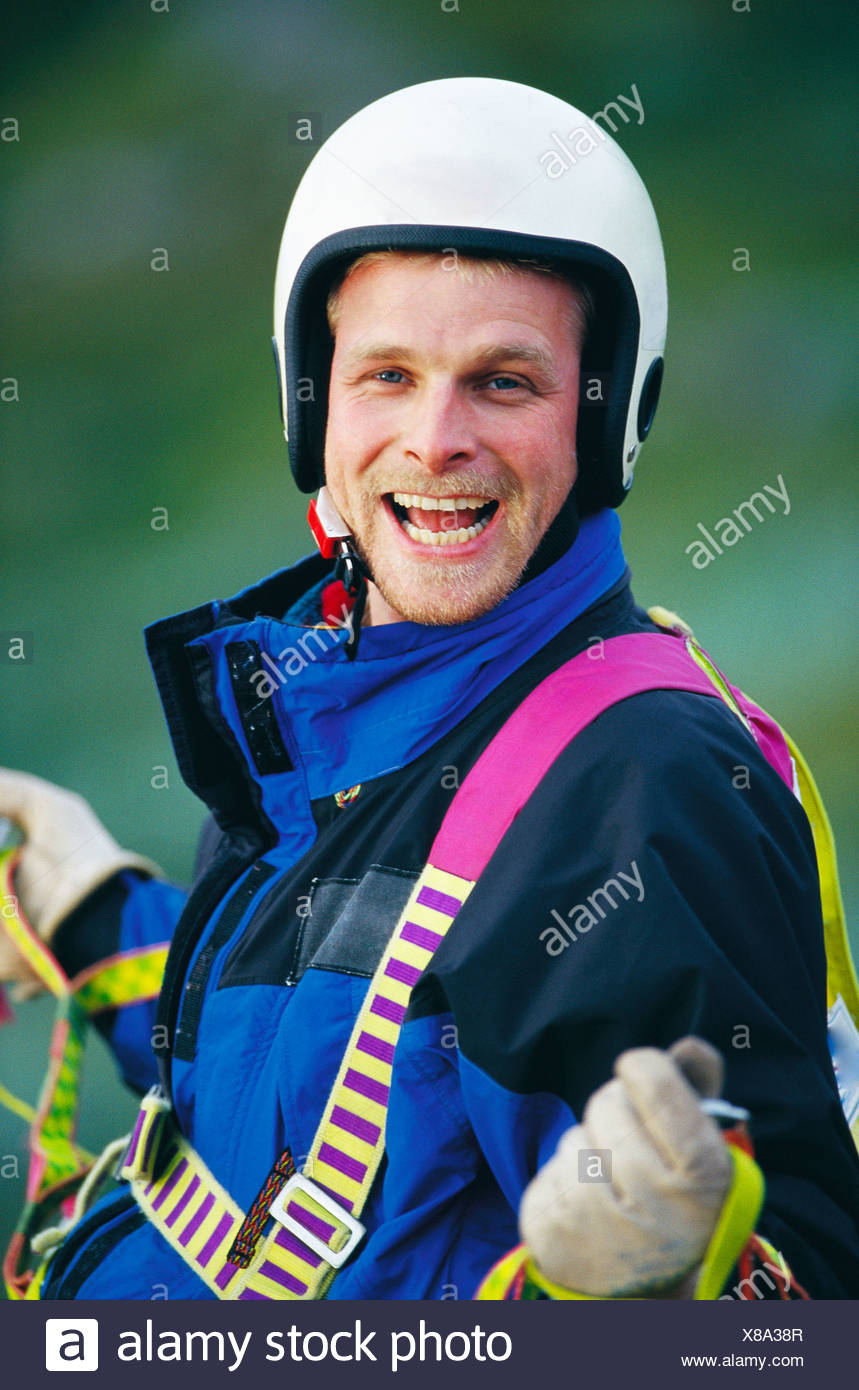 Portrait of paraglider laughing - Stock Image