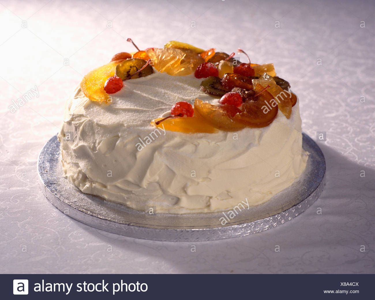 Close Up Of Iced Birthday Cake Decorated With Candied Fruit Stock