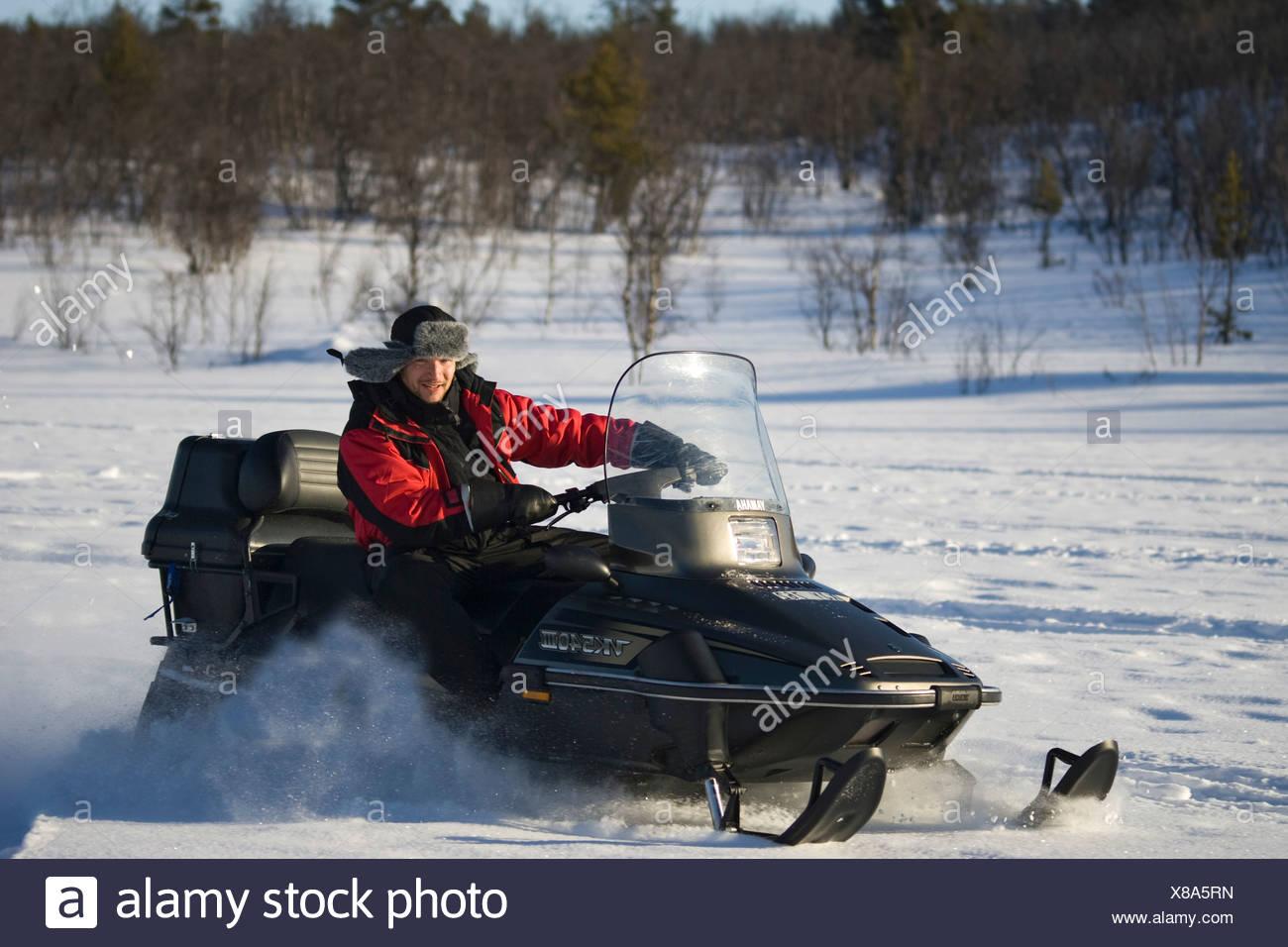 A snowmobile rider in Kiruna, North Sweden, Sweden - Stock Image