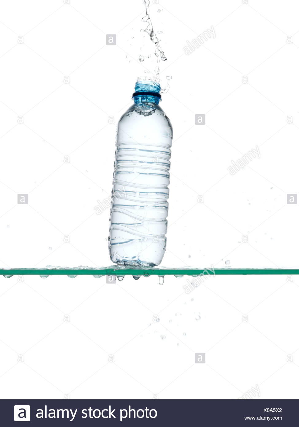 Bottle of water being dropped - Stock Image