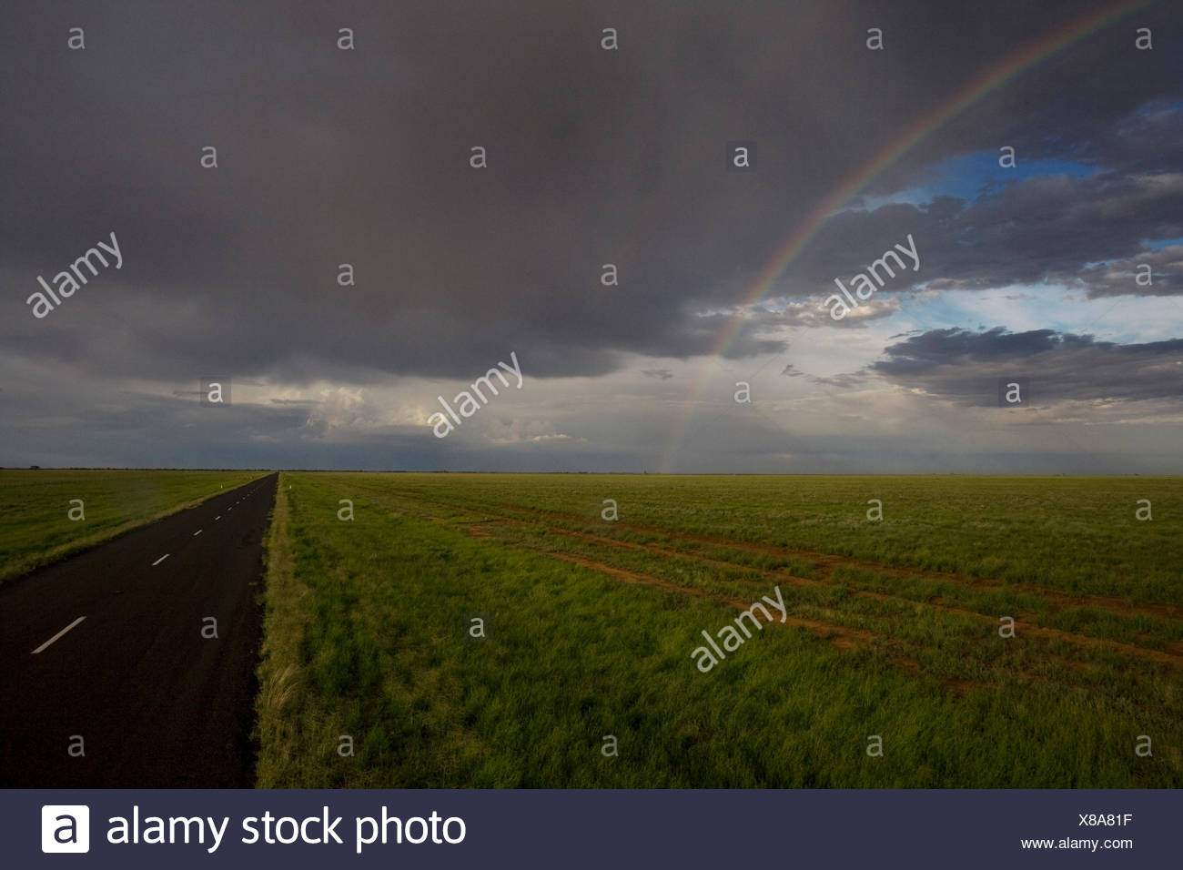 A rainbow appears after a storm. - Stock Image