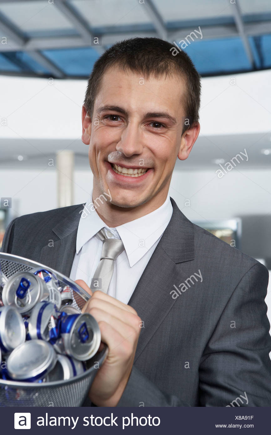 Young businessman with bin - Stock Image