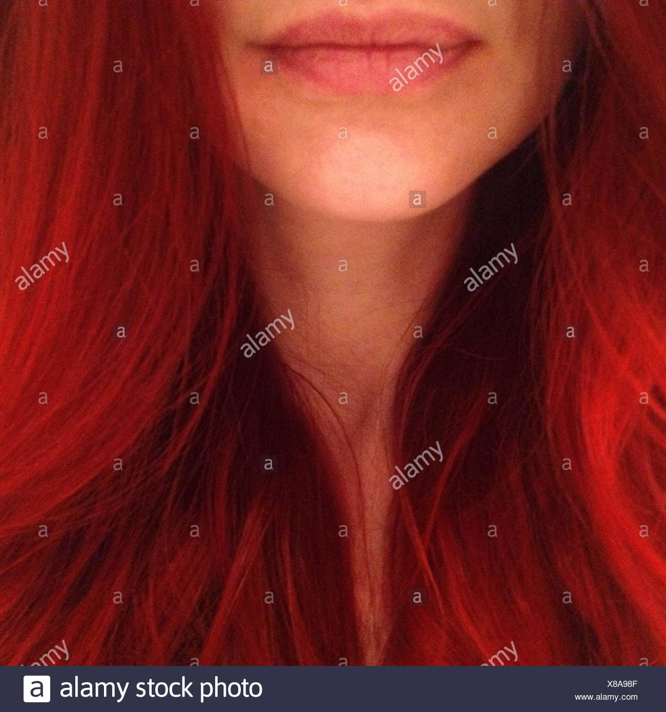 Close-Up Of Young Woman With Red Hair - Stock Image
