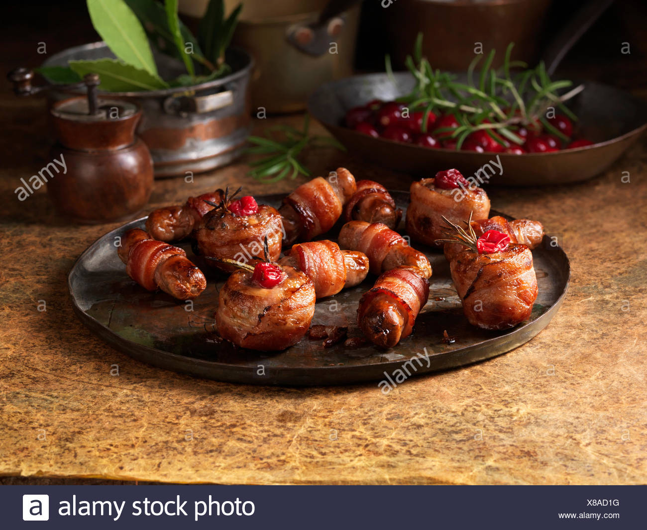Christmas, celebration food, garnish selection, pigs in blankets, cranberries, rosemary - Stock Image