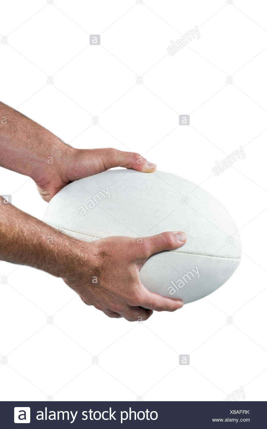 Sports player holding ball - Stock Image