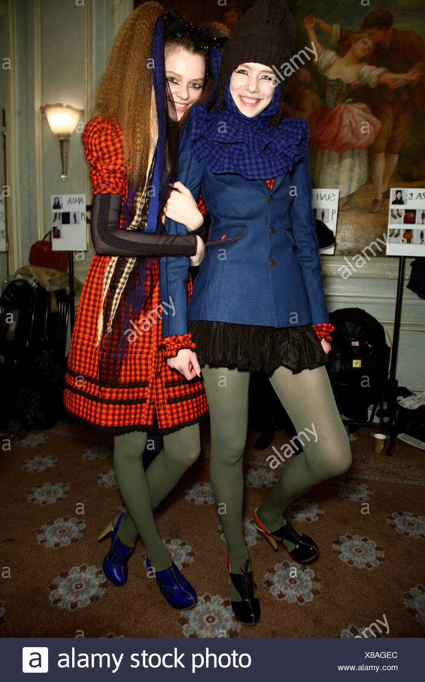 893bc3efc9c4f Two females wearing checked outfits and green tights, smiling at camera