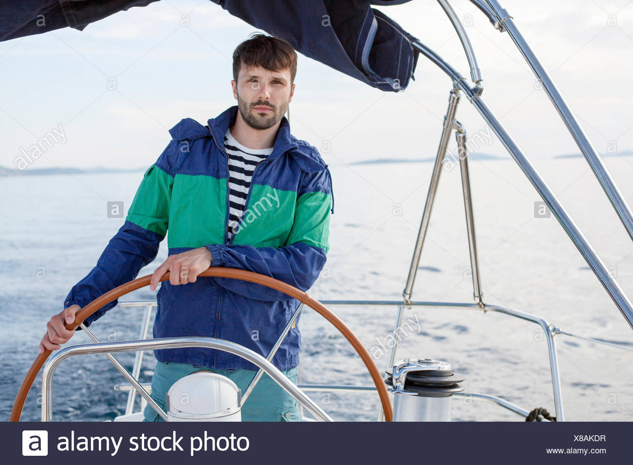 Man steering sailboat, Adriatic Sea - Stock Image