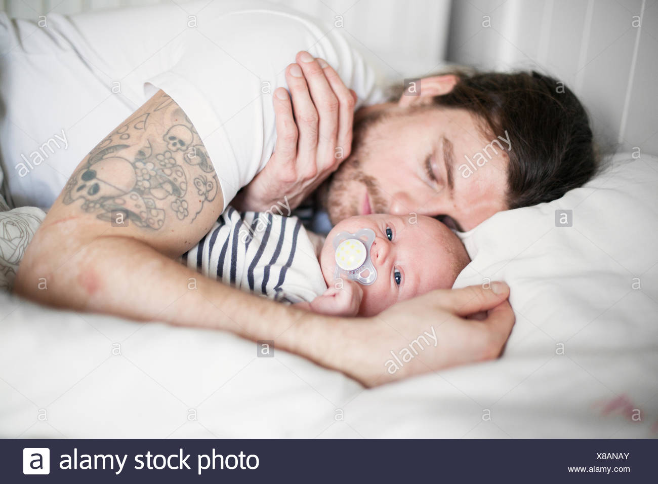 Sweden, Father and baby boy (0-1 months) resting - Stock Image
