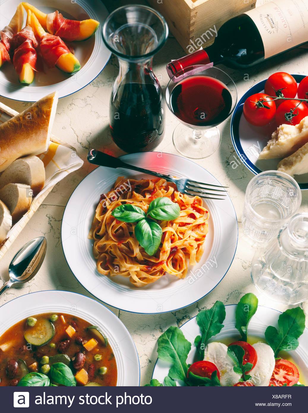 Italian national cuisine, Tagliatelle with tomato sauce, Parmesan cheese, mozzarella cheese, minestrone soup - Stock Image