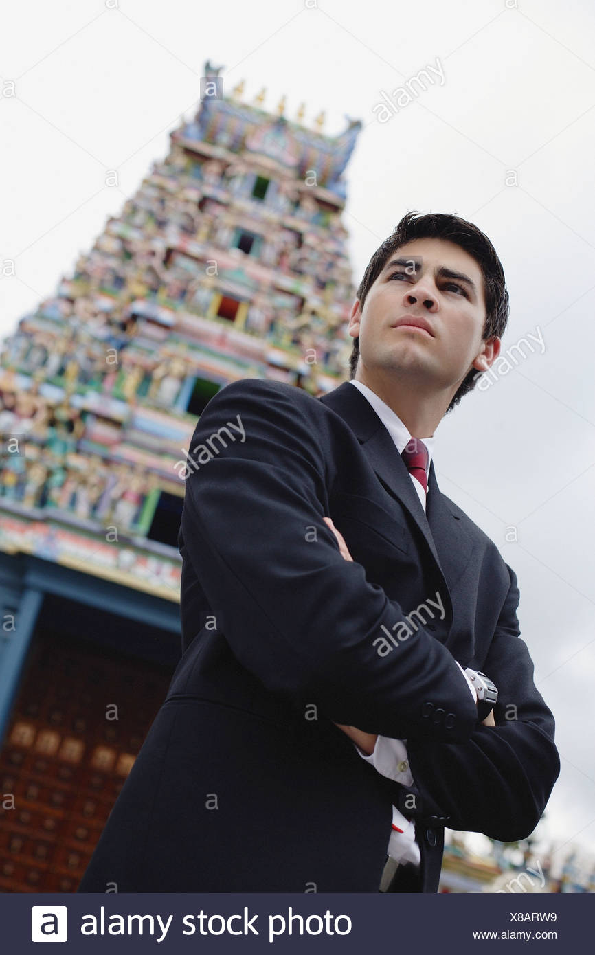 Businessman Standing With Arms Crossed Hindu Temple In The