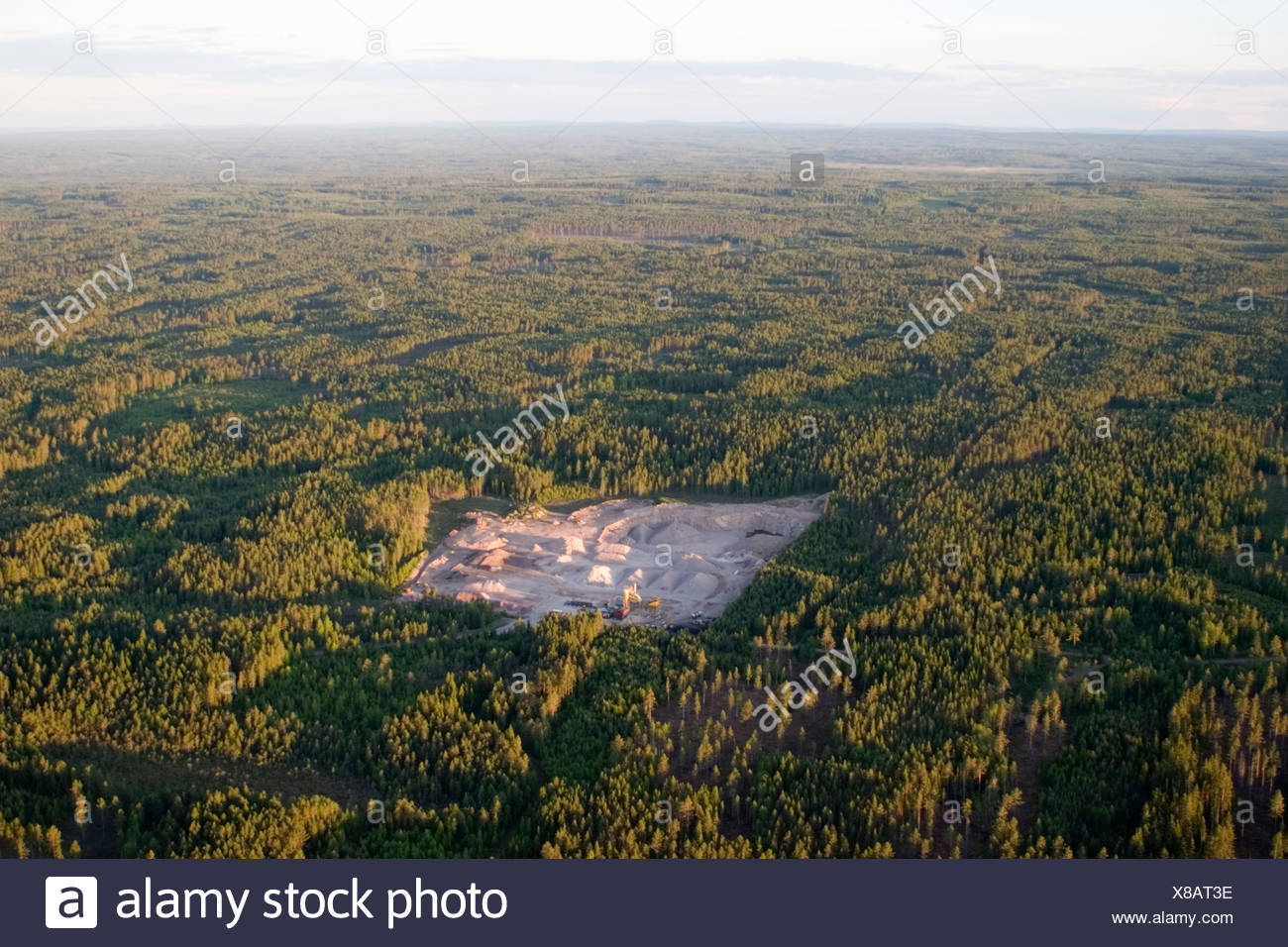 A gravel pit in a forest, aerial view, Sweden. - Stock Image