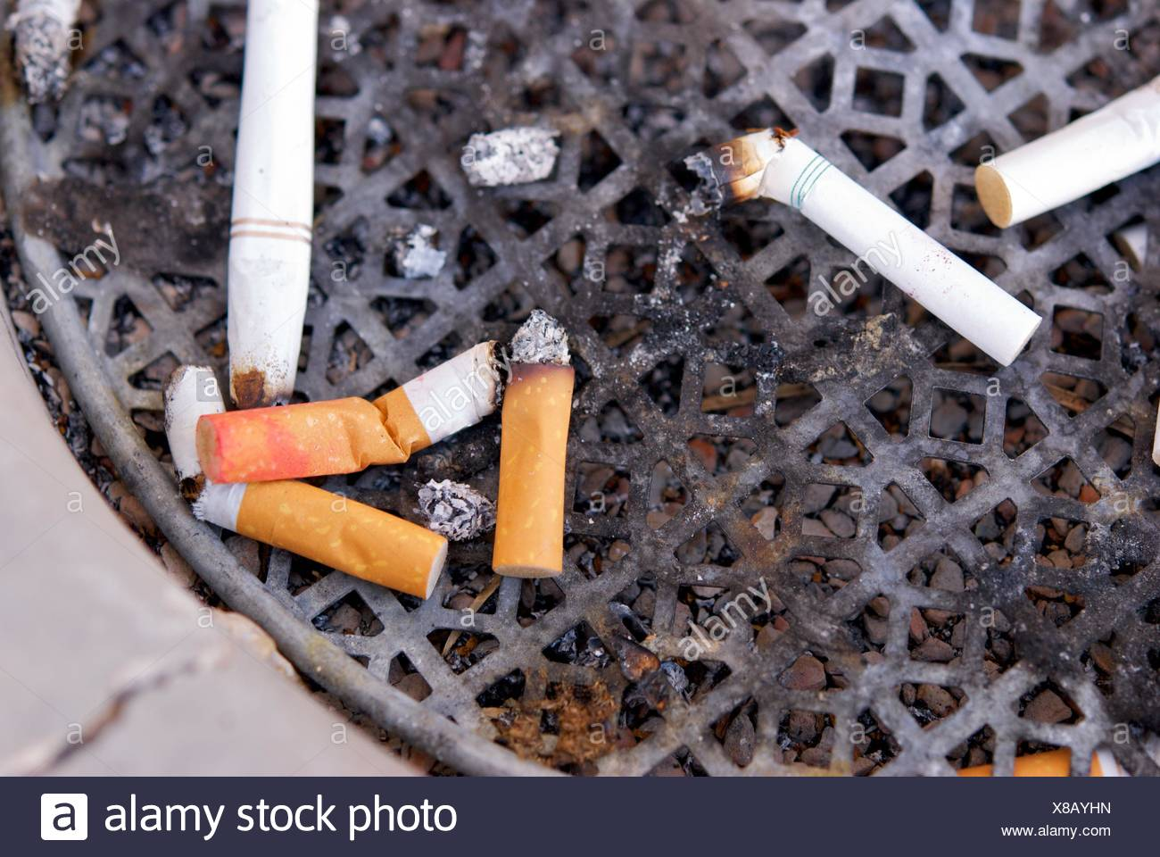 Cigarette Ashtray with Used Filters - Stock Image