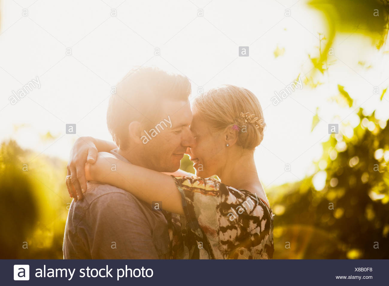 Italy, Tuscany, Portrait of mature couple embracing - Stock Image