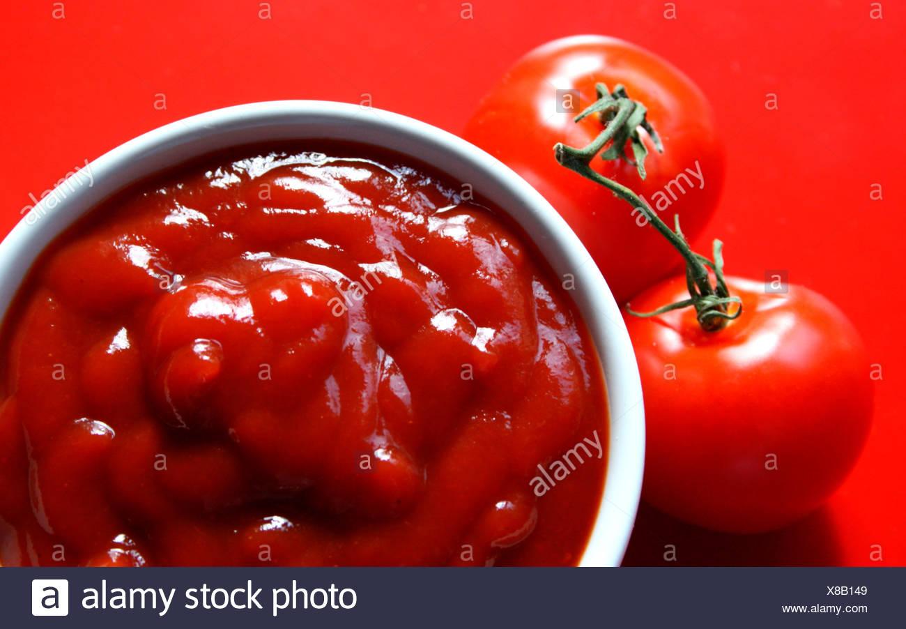 Ketchup and tomatoes - Stock Image