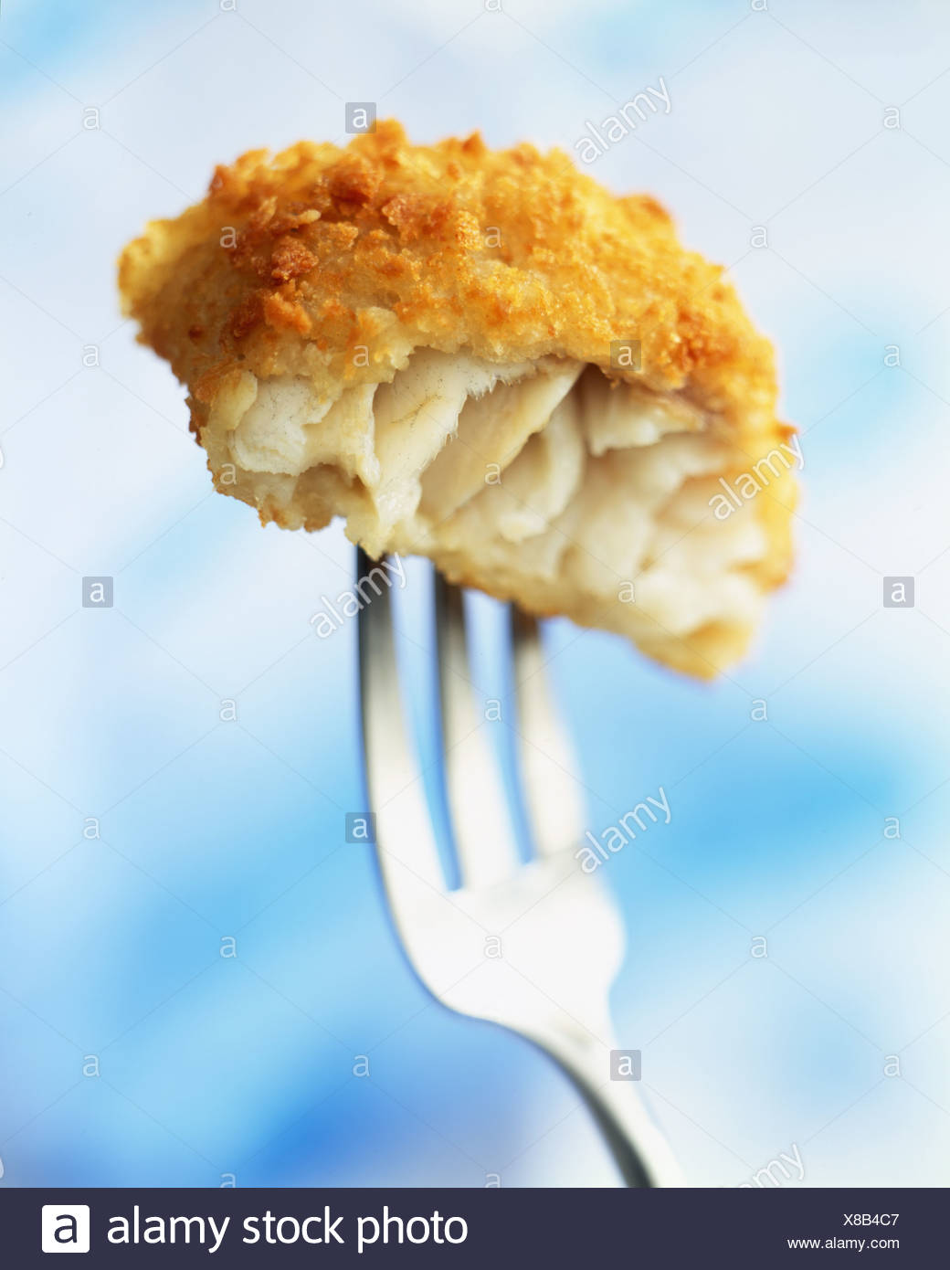 Crunchy breaded cod on fork Stock Photo