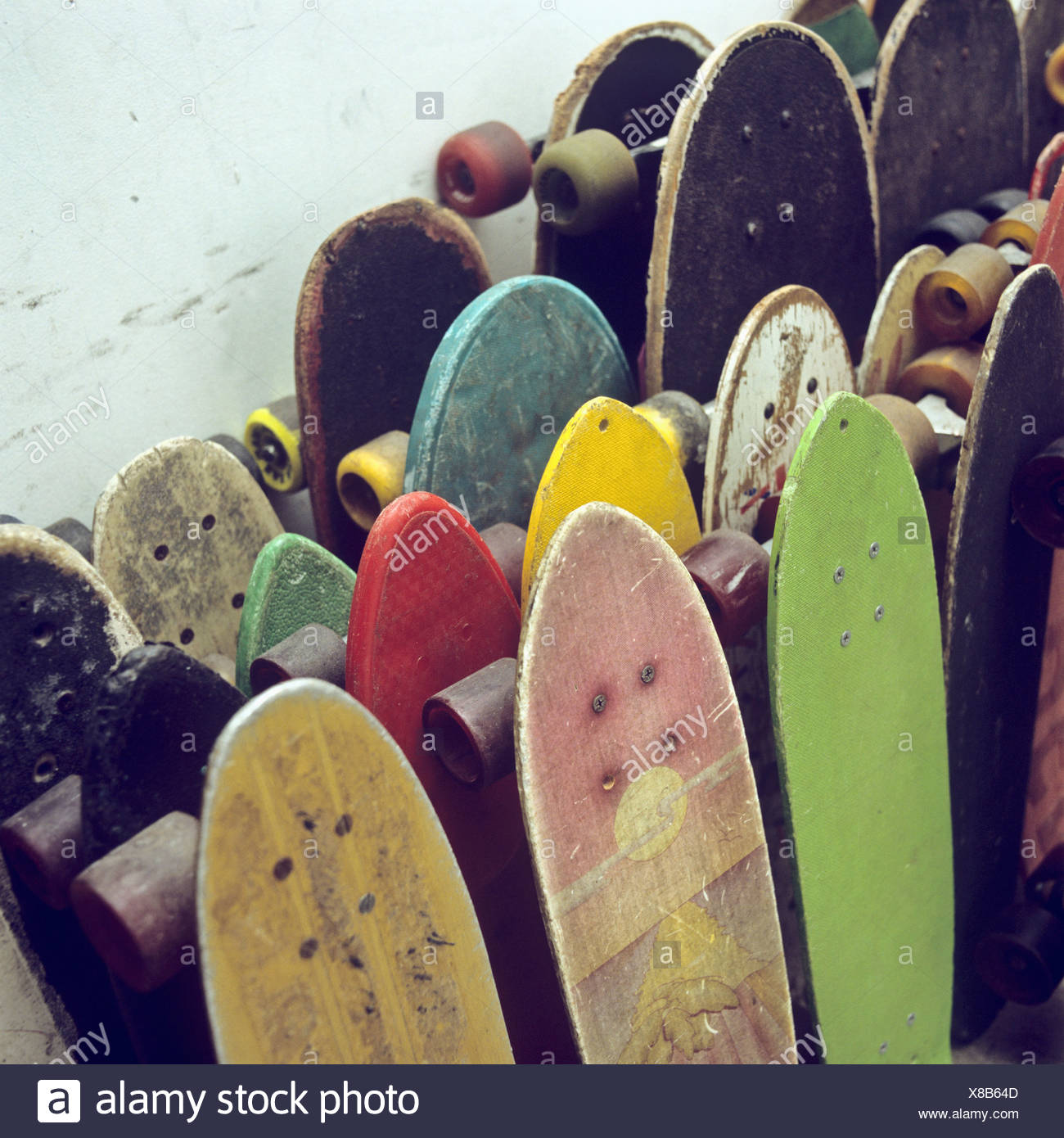 5cdb7d075c Rows of used skateboards leaning against a wall Stock Photo ...