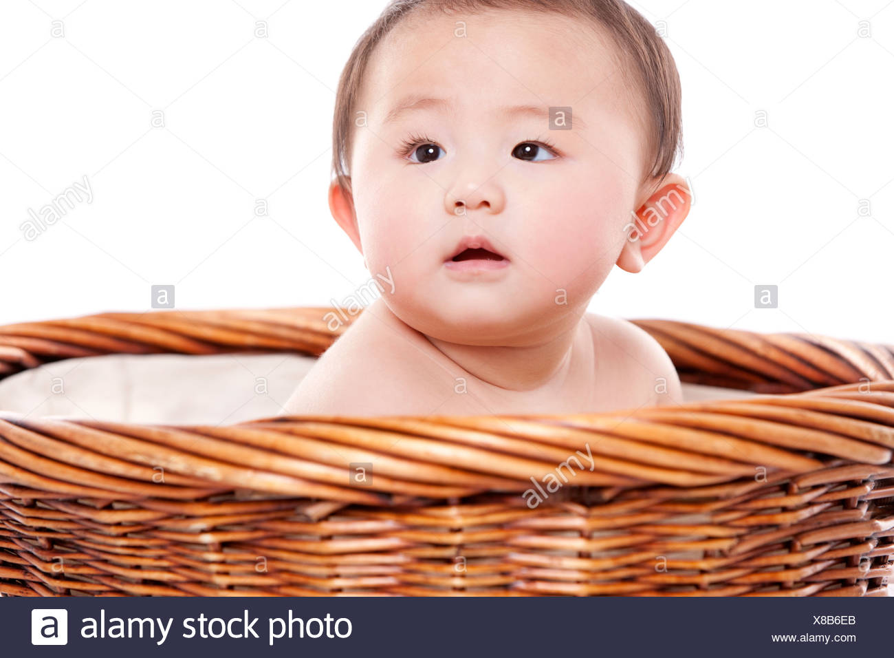 d2450e119 Cute baby girl sitting in basket Stock Photo  280529715 - Alamy